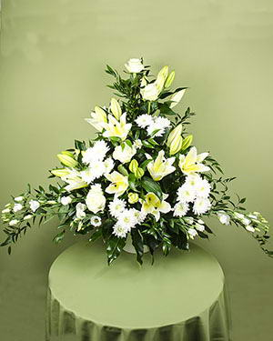 Funeral arrangement with white flowers