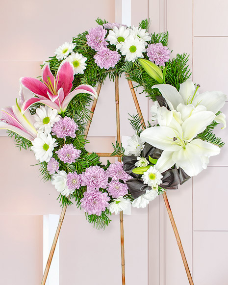 Funeral wreath with lilies and chrysanthemums