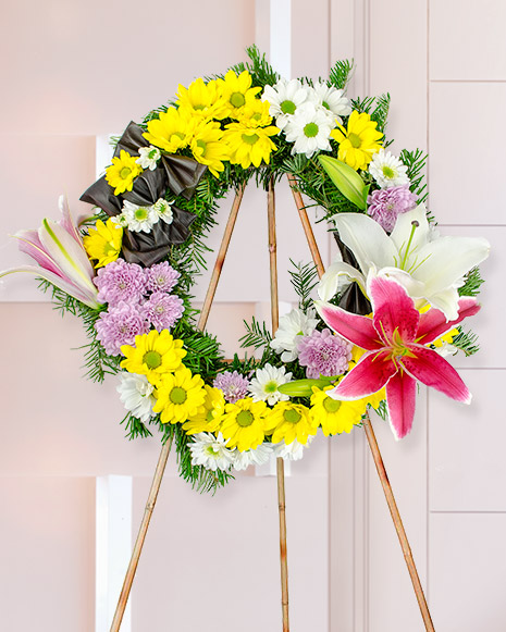 Funeral wreath with yellow and white chrysanthemums
