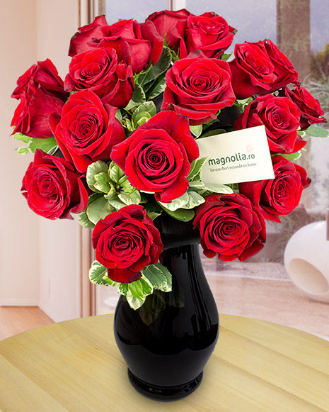 Bouquet of red roses and greenery