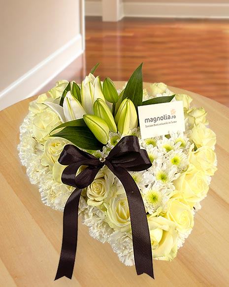 Floral funeral heart with white roses and chrisanthemums