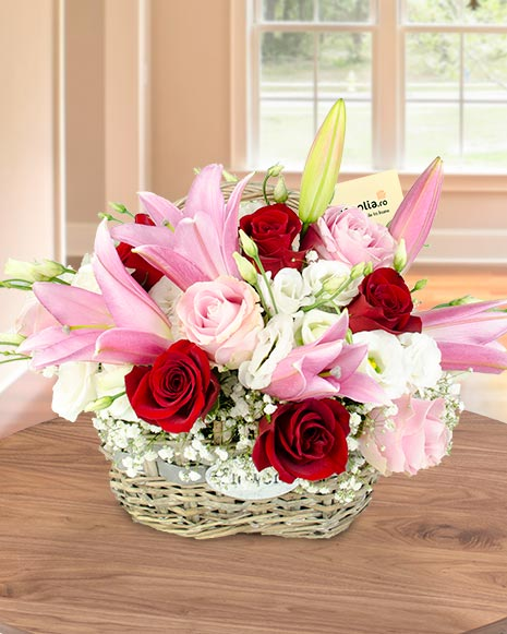 Basket arrangement with white and pink flowers