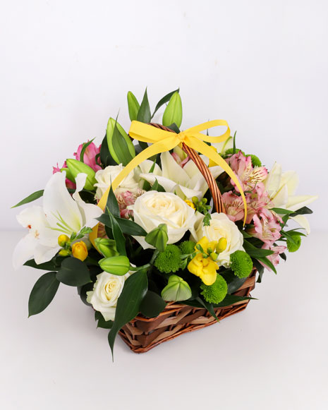 Basket with white lilies