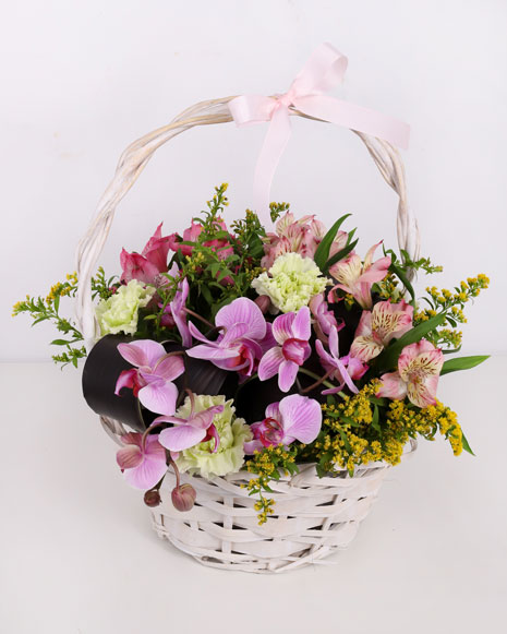 Basket with orchids and solidago