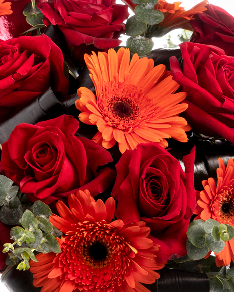 Bouquet with red roses and orange gerberas