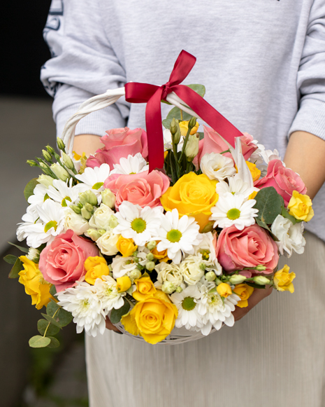 Basket with chrysanthemums and roses