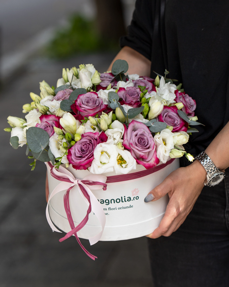 Box with purple roses and freesias