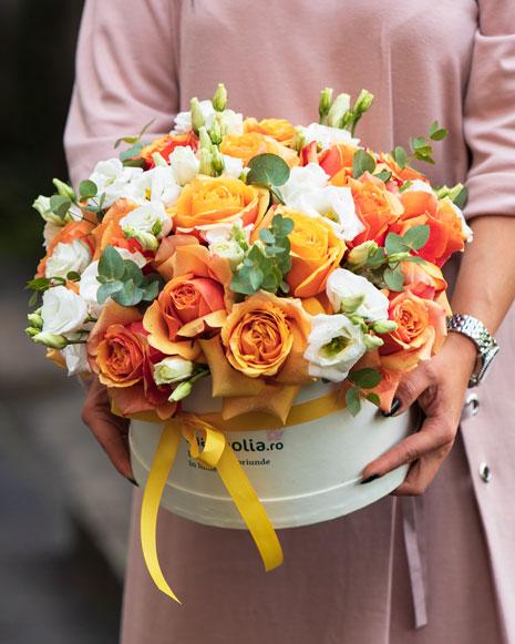 Box with orange roses and eustoma