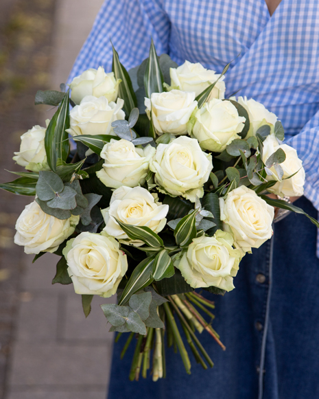 Bouquet with white roses and greenery