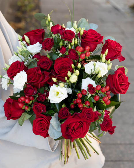Bouquet of red roses and hypericum