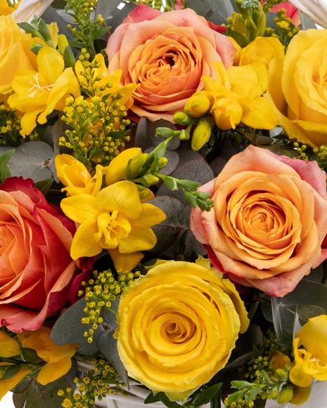 Freesias and roses basket arrangement