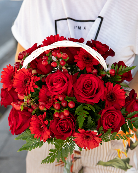 Basket with red gerbera and roses