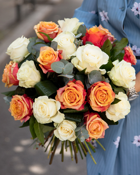 Bouquet of white and orange roses