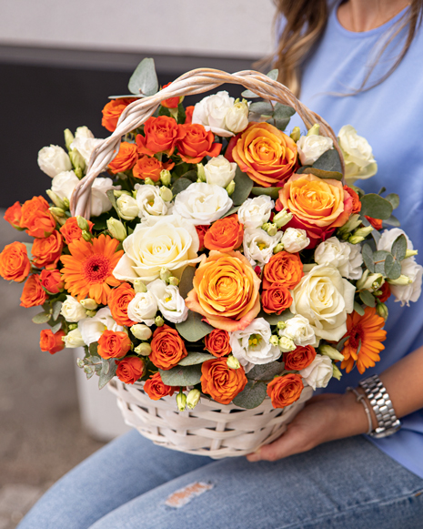 Basket of white and orange flowers