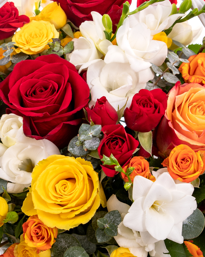 Basket with multicolored roses