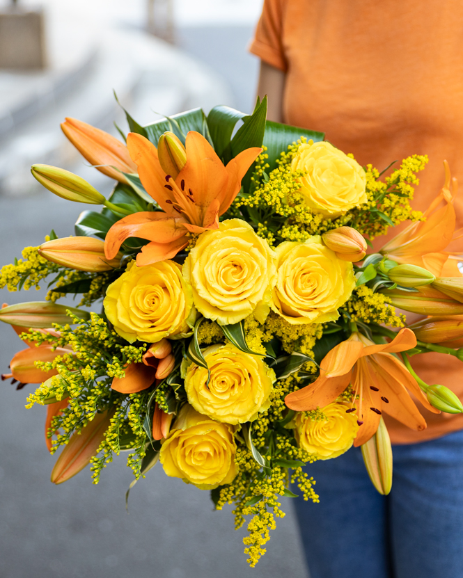 Bouquet of yellow roses and orange lilies