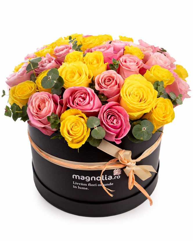 Box arrangement of pink and yellow roses