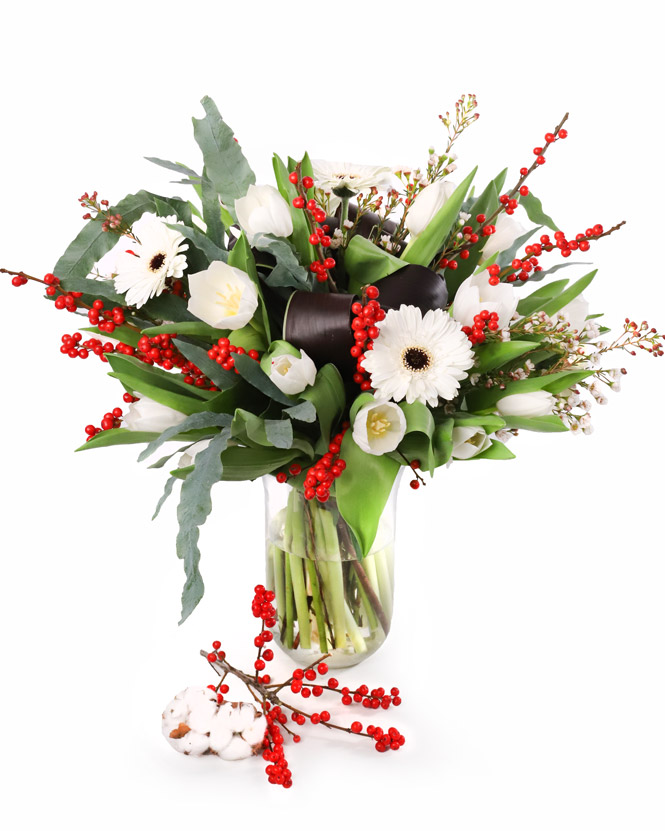 Bouquet of tulips and winter decorations