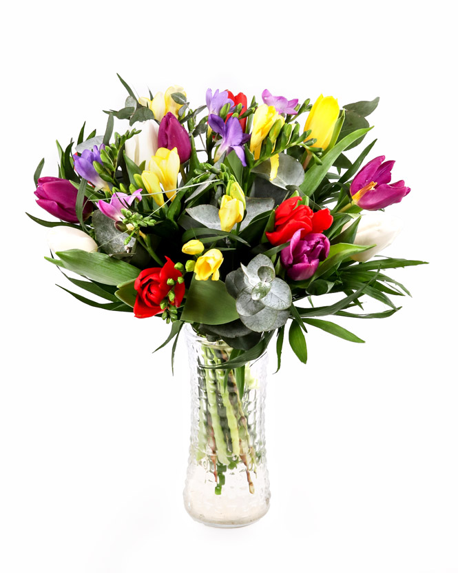 Bouquet with multicolored freesias, tulips and greenery