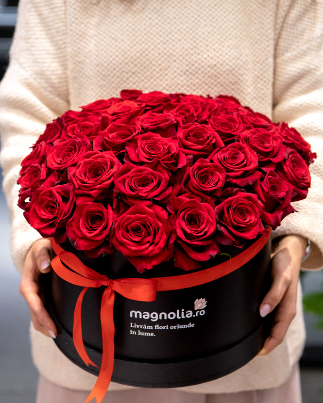 Arrangement in box with red roses
