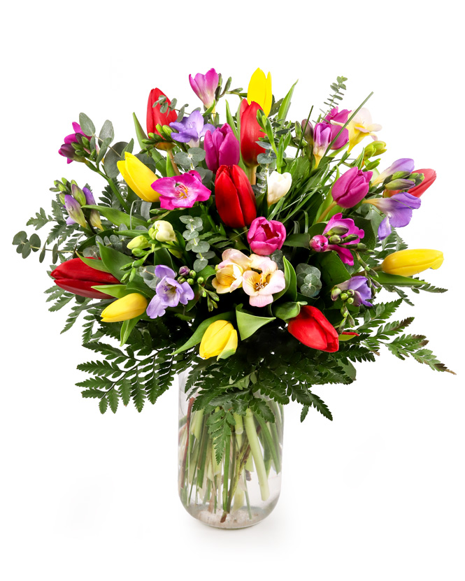 Bouquet with tulips and freesias and greenery