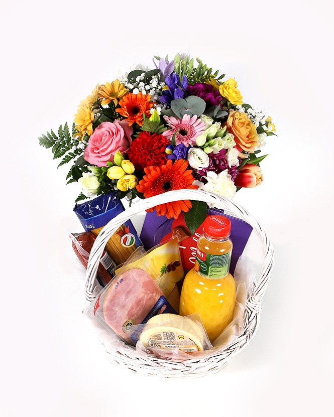 Tasty gift basket and colorful bouquet