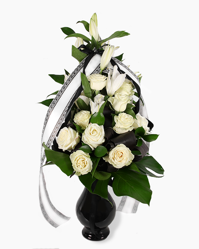 Funeral bouquet with roses and lilies