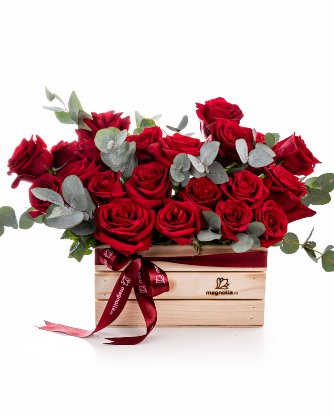 Wooden box with red roses
