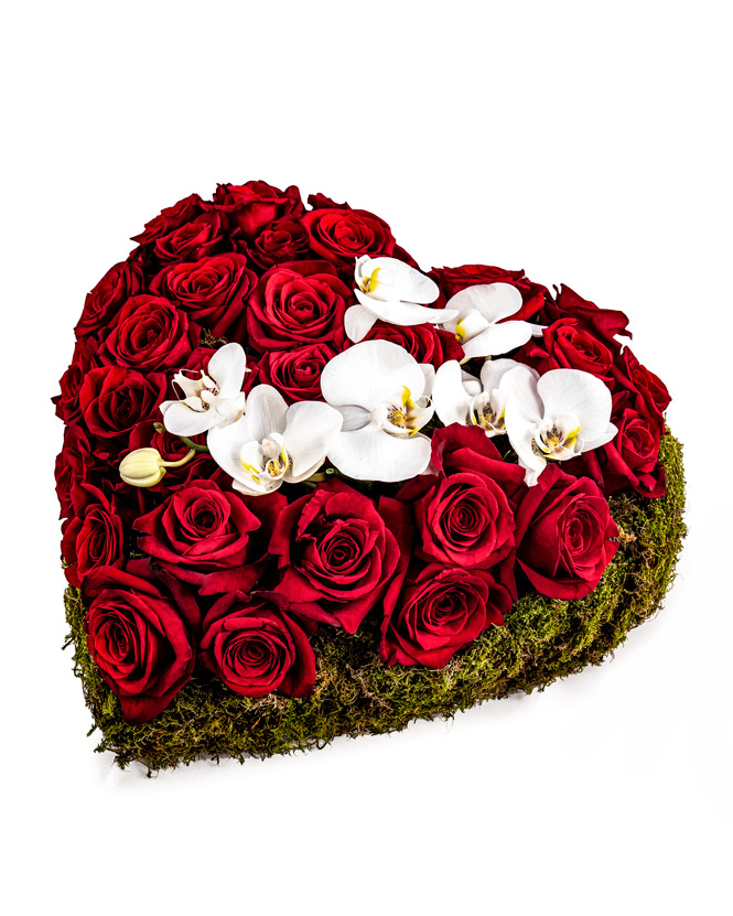 Rose and orchid heart arrangement