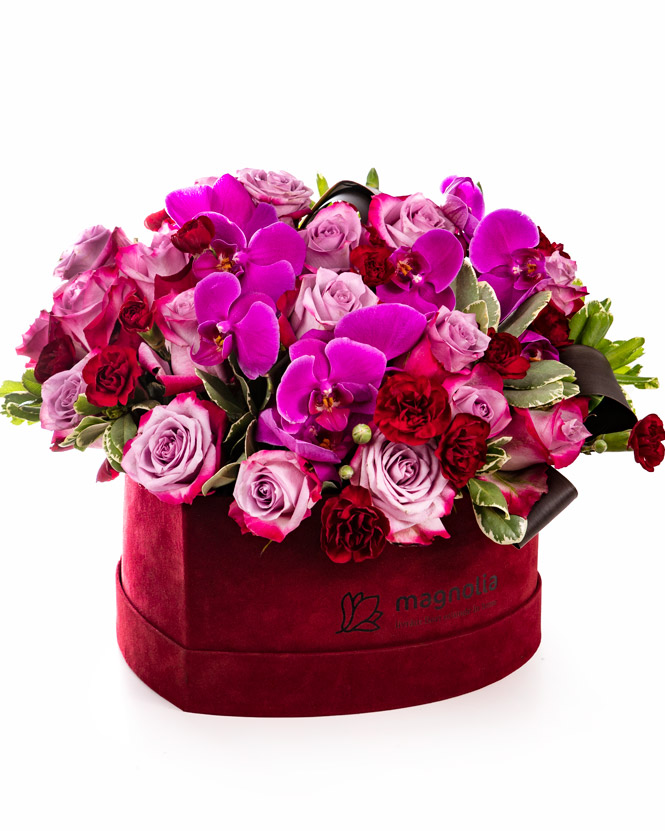 Orchids and roses in heart box