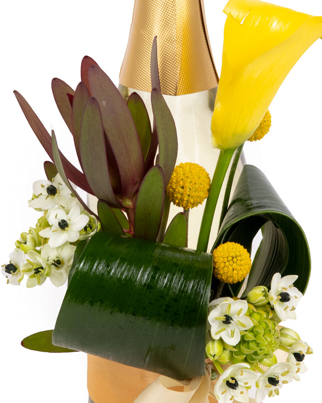 Floral arrangement on a champagne bottle