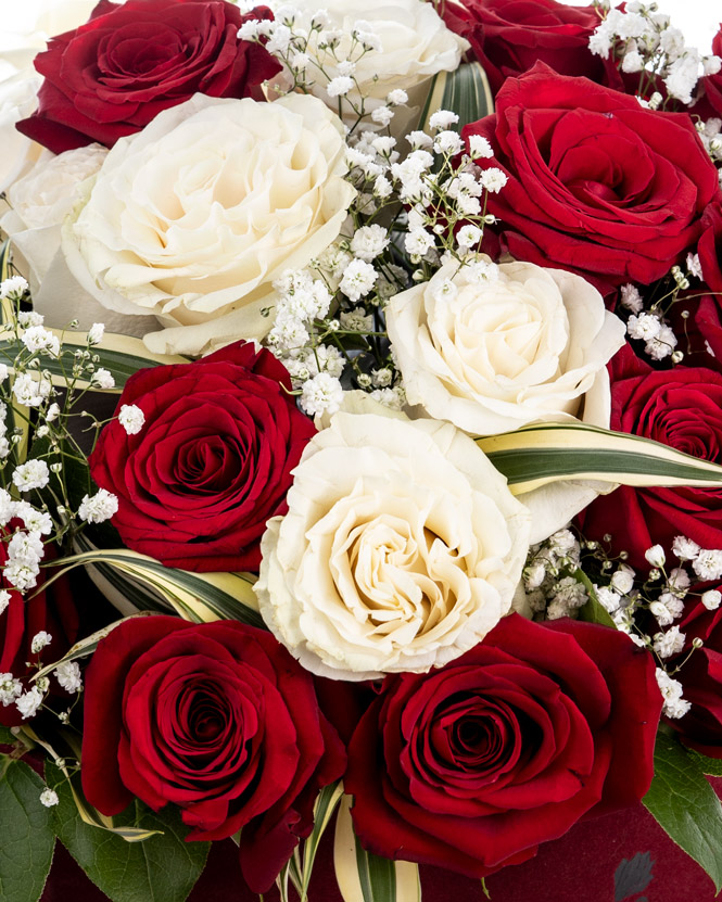 White and red roses in heart shaped box