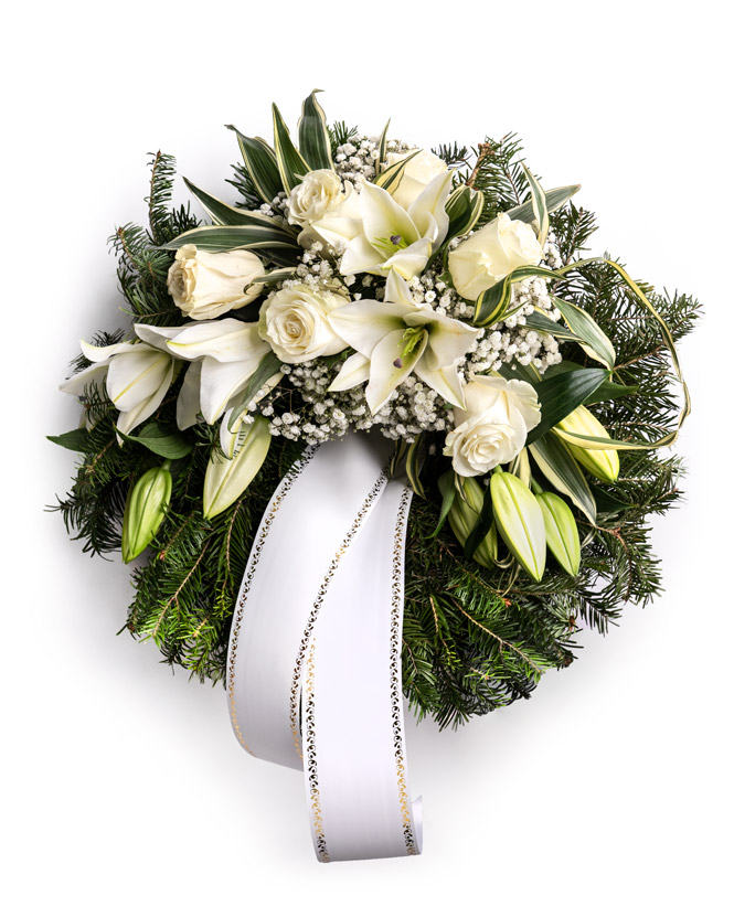 Funeral wreath with white roses and lilies