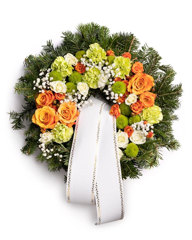 Jerbă funerară cu trandafiri portocalii și garoafe