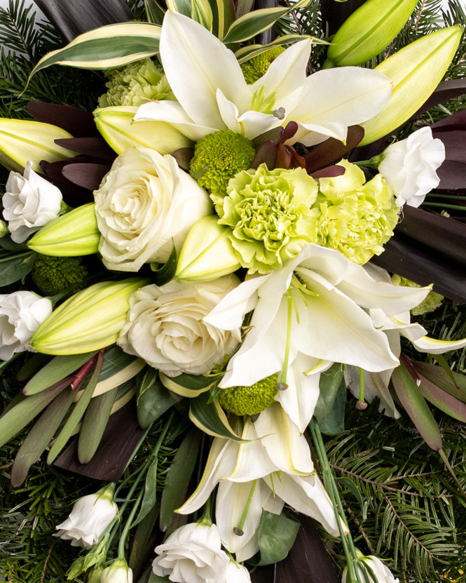 Funeral wreath with carnations and lilies