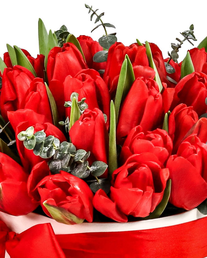 Box with red tulips