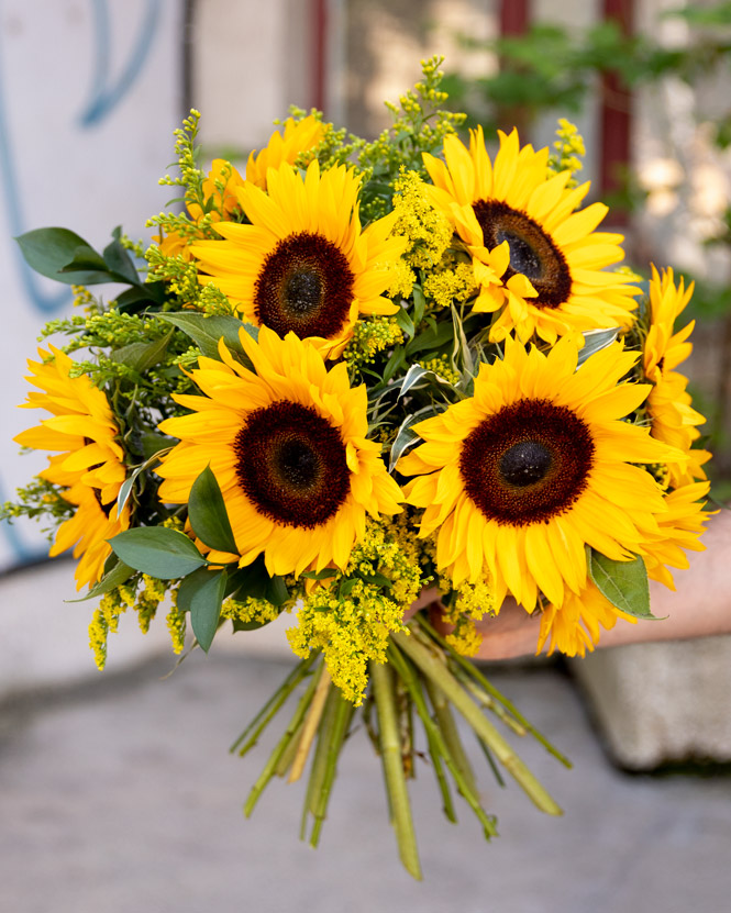 Bouquet with sunflower and solidago