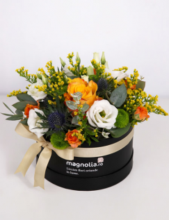Box with white and orange flowers