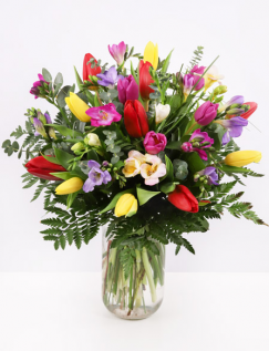 Bouquet tulips and freesias and greenery